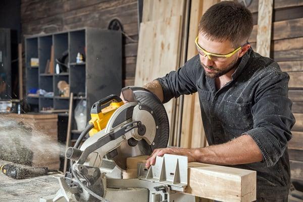 circular saw-white man-shutterstock_671051731