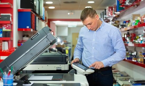 photocopier-white man-40s-shutterstock_1608285598
